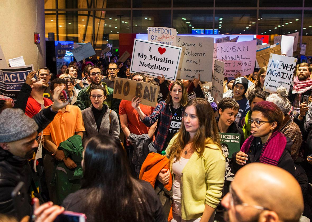 Protestors rally at a demonstration against the new ban on immigration issued by President Donald Trump at Logan International Airport on January 28, 2017 in Boston, Massachusetts.