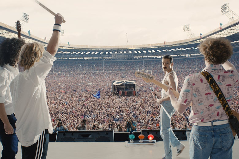 Rami Malek as Freddie Mercury in front of Live Aid's massive crowd.