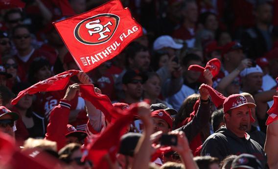 A 49er fan waving a flag.