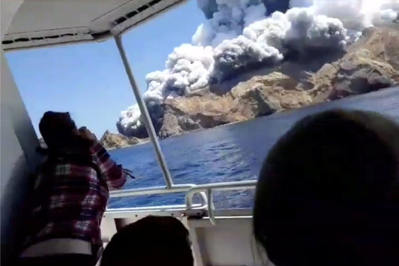 Smoke billows from the volcanic eruption of White Island, also known by its Maori name Whakaari, on Monday in this screengrab obtained from a social media video.
