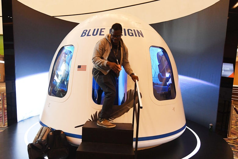 Participants leave the Blue Origin Space Simulator during the Amazon Re:MARS conference on robotics and artificial intelligence at the Aria Hotel in Las Vegas, Nevada on June 5, 2019.