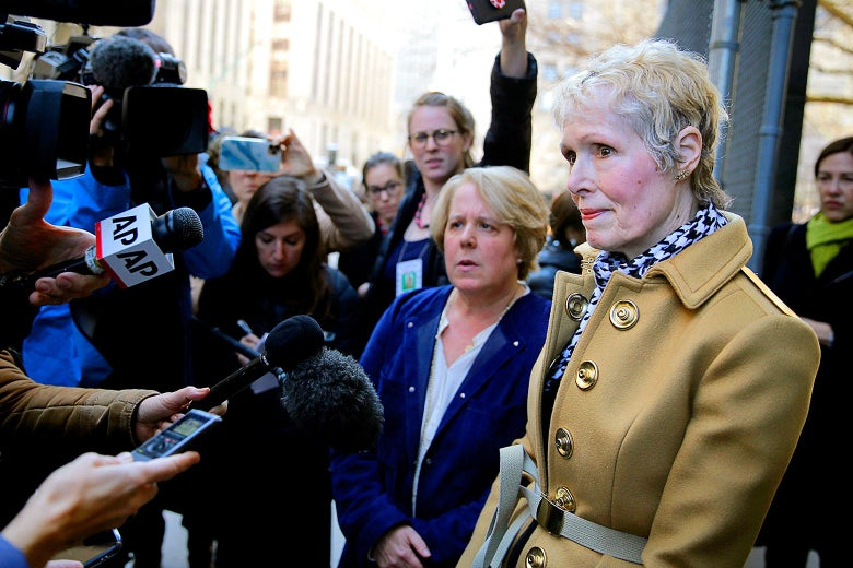 E. Jean Carroll talks to reporters outside of a courthouse.