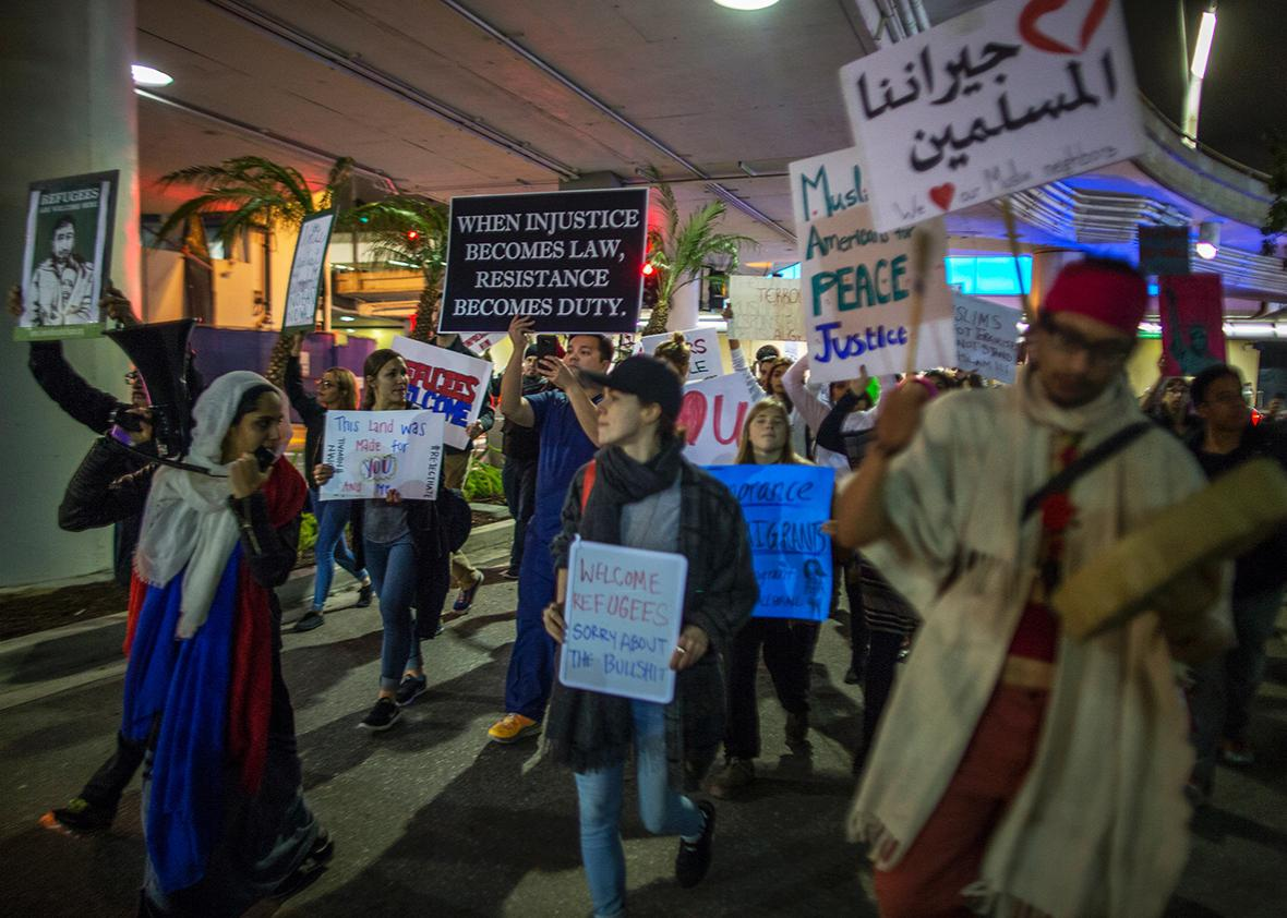 Demonstrators march in support of a ruling by a federal judge in Seattle that grants a nationwide temporary restraining order against the presidential order to ban travel to the United States from seven Muslim-majority countries, inside the Tom Bradley International Terminal at Los Angeles International Airport on February 4, 2017 in Los Angeles, California.