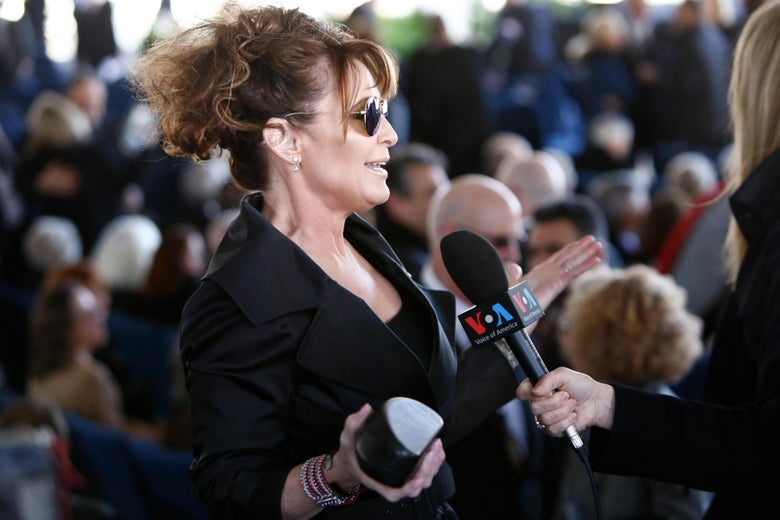 Sarah palin appears to be posting sponsored content for skinny tea sarah palin wearing black talks to a voice of america reporter at billy grahams altavistaventures Images