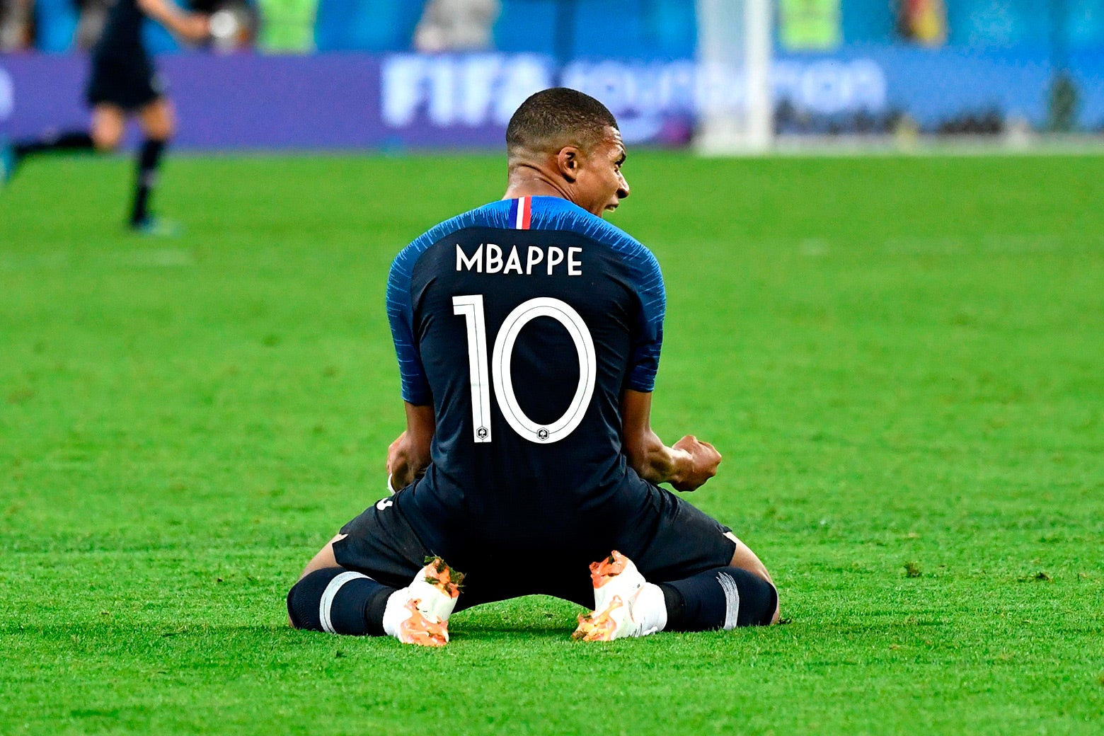 Kylian Mbappe celebrates at the end of the World Cup semifinal football match between France and Belgium in Saint Petersburg on July 10.