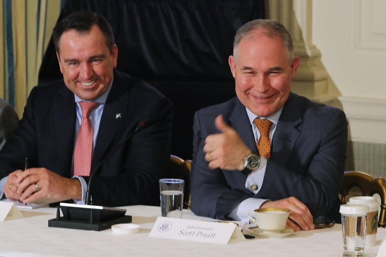 WASHINGTON, DC - FEBRUARY 12:  Environmental Protection Agency Administrator Scott Pruitt (R) gives a thumbs-up during a meeting with Utah Speaker of the House Greg Hughes and other state and local leaders where U.S. President Donald Trump unveiled his administration's long-awaited infrastructure plan in the State Dining Room at the White House February 12, 2018 in Washington, DC. The $1.5 trillion plan to repair and rebuild the nation's crumbling highways, bridges, railroads, airports, seaports and water systems is funded with $200 million in federal money with the remaining 80 percent coming from state and local governments.  (Photo by Chip Somodevilla/Getty Images)