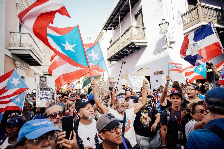 Demonstrators protest in front of the mansion of Puerto Rico's governor.