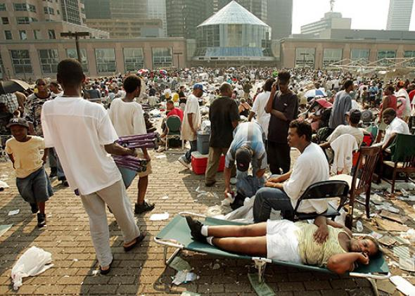 Stranded victims of Hurricane Katrina wait outside the Superdome
