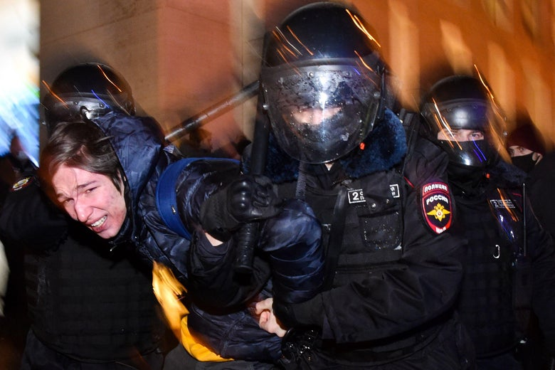 Riot police detain a protester during a rally in support of jailed opposition leader Alexei Navalny in downtown Moscow on January 23, 2021.