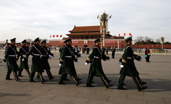 Chinese paramilitary police march on Tiananmen Square as security is stepped up ahead of the annual parliament session at the Great Hall of the People in Beijing on March 2, 2010.