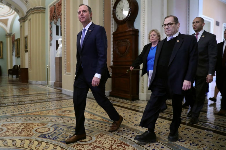 Rep. Adam Schiff (D-CA) strides across the Capitol floor outside the Senate chamber, followed by Rep. Zoe Lofgren (D-CA), Rep. Jerrold Nadler (D-NY) and Rep. Hakeem Jeffries (D-NY).