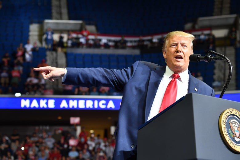 Trump pointing while on stage at a campaign rally