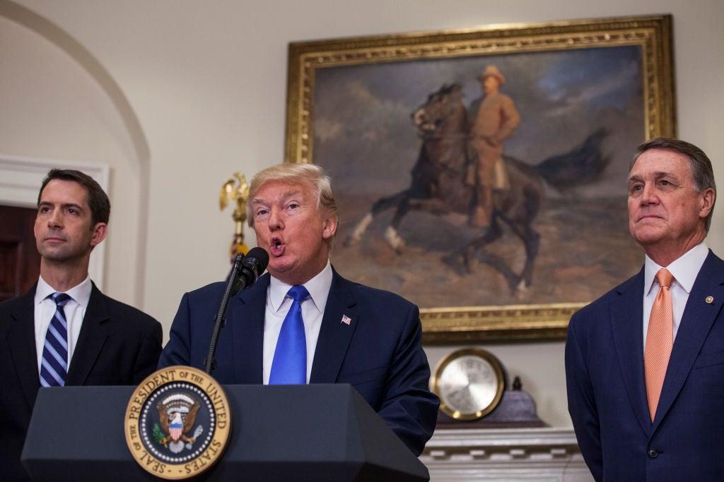 Arkansas Sen. Tom Cotton, Donald Trump, and Georgia Sen. David Perdue at the White House on Aug. 2, 2017.