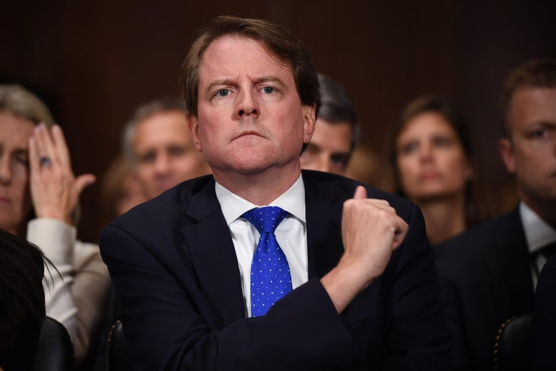 Former White House Counsel Don McGahn listens during the Supreme Court confirmation hearings for Brett Kavanaugh.