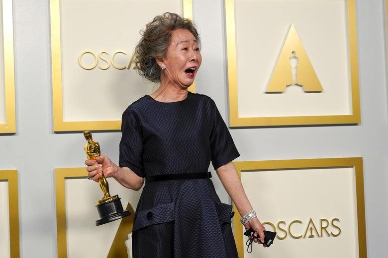 yuh-jung youn looks delighted as she holds her oscar