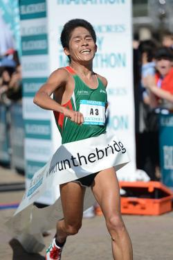 In this handout photo provided by the Sydney Running Festival, Yuki Kawauchi of Japan crosses the line to win in record time in the marathon during the Sydney Running Festival on September 16, 2012 in Sydney, Australia.,71388746