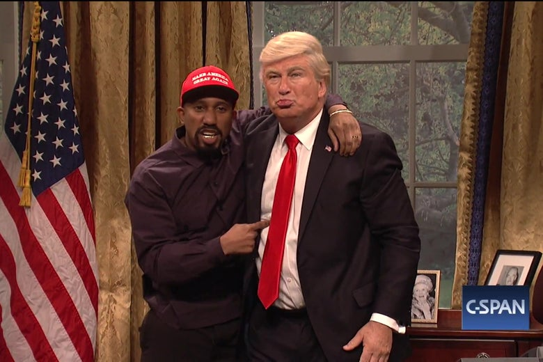 Chris Redd, dressed as Kanye West, embraces Alec Baldwin, dressed as Donald Trump.