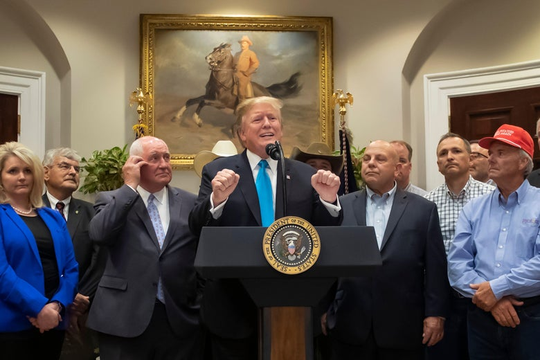 President Donald Trump and some farmers he's bailing out, in Washington.