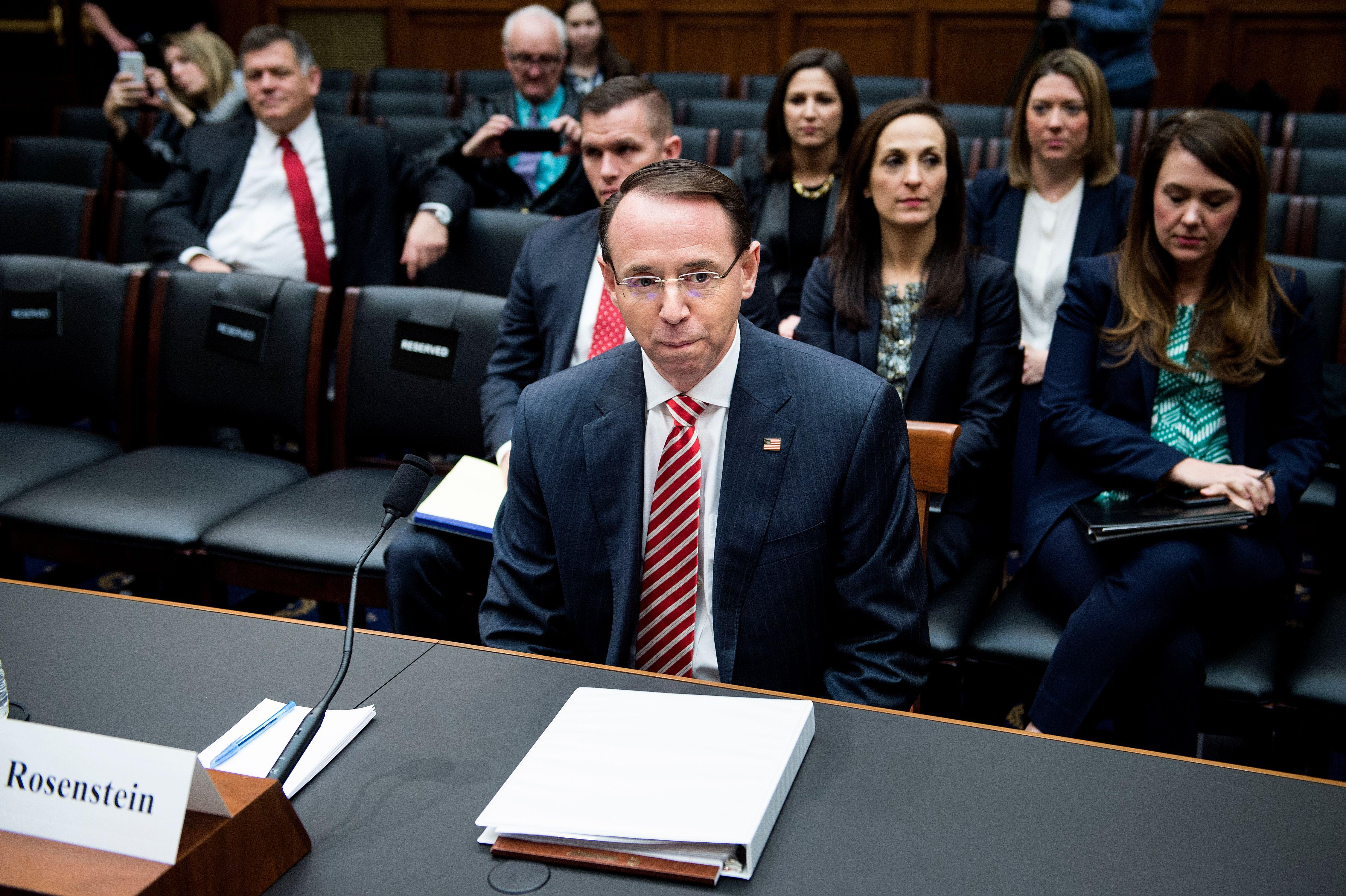 Deputy Attorney General Rod Rosenstein waits for a hearing of the House Judiciary Committee on Oversight on Wednesday in Washington.