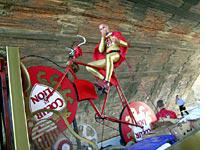 This cyclist rides his giant bike through the entire Tour, all in the name of cheese