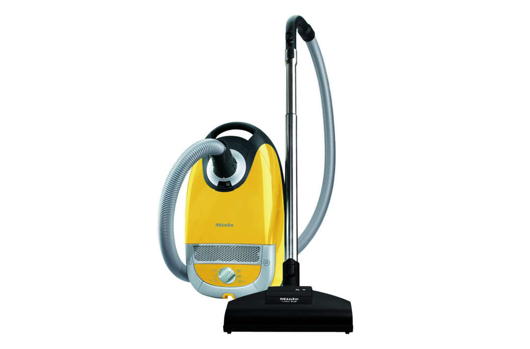 Miele yellow corded vacuum.