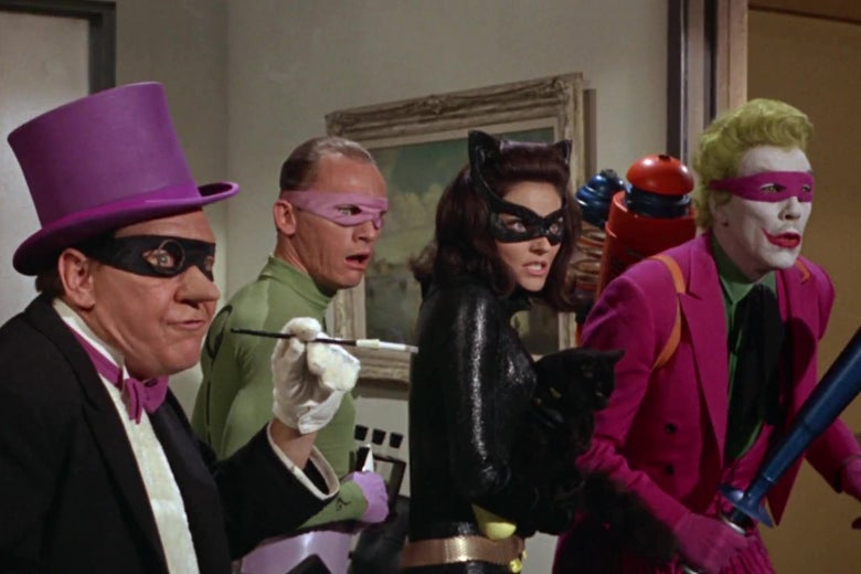 The Penguin, the Riddler, Catwoman, and the Joker looking shocked in a still from the 1966 Batman movie.