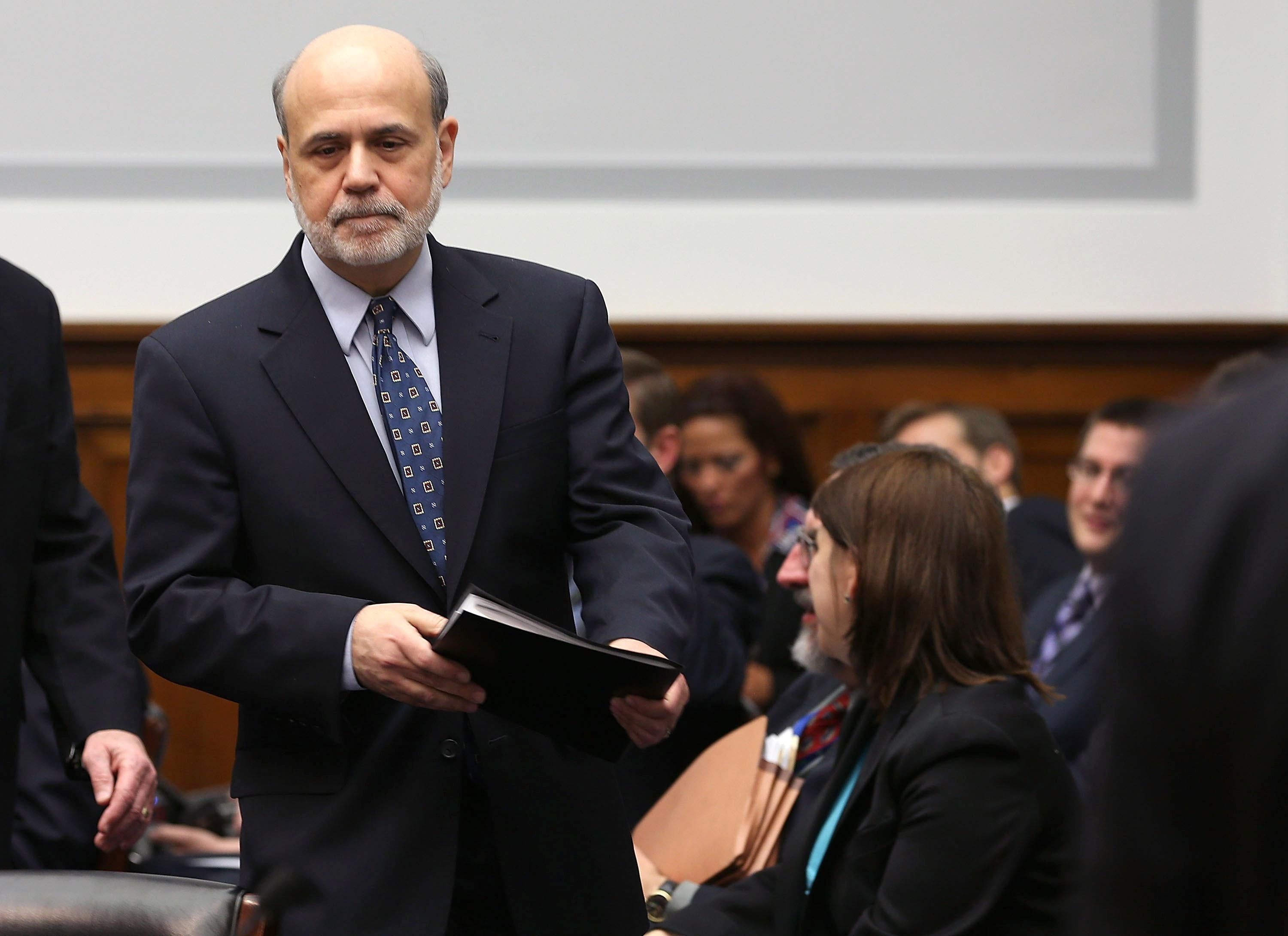 Federal Reserve Board Chairman Ben Bernanke arrives at a House Financial Services Committee hearing on Capitol Hill, Feb. 27, 2013.