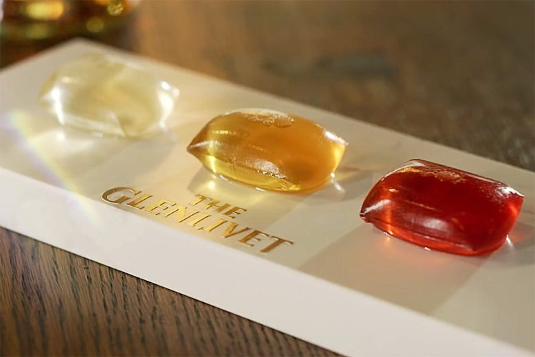 Three Glenlivet whisky cocktail pods of different colors.