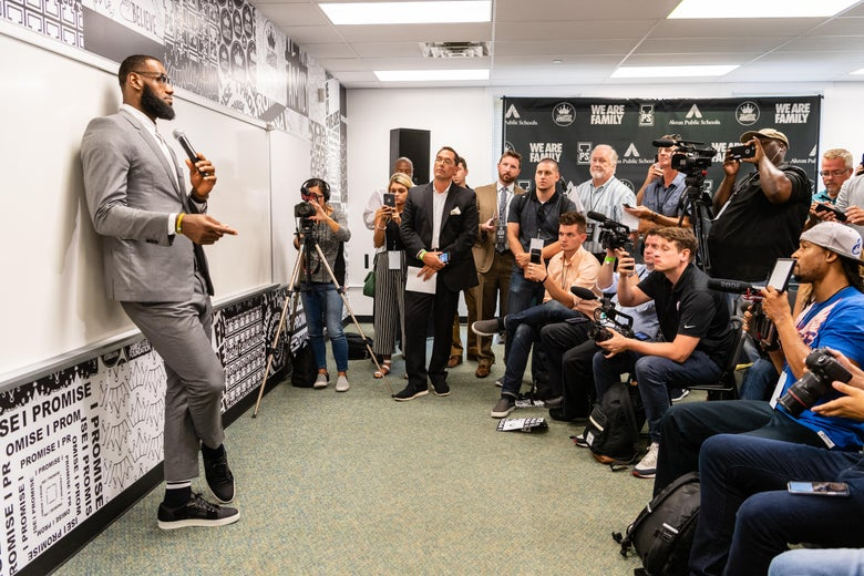In a classroom at I Promise School, LeBron James speaks before a scrum of reporters.
