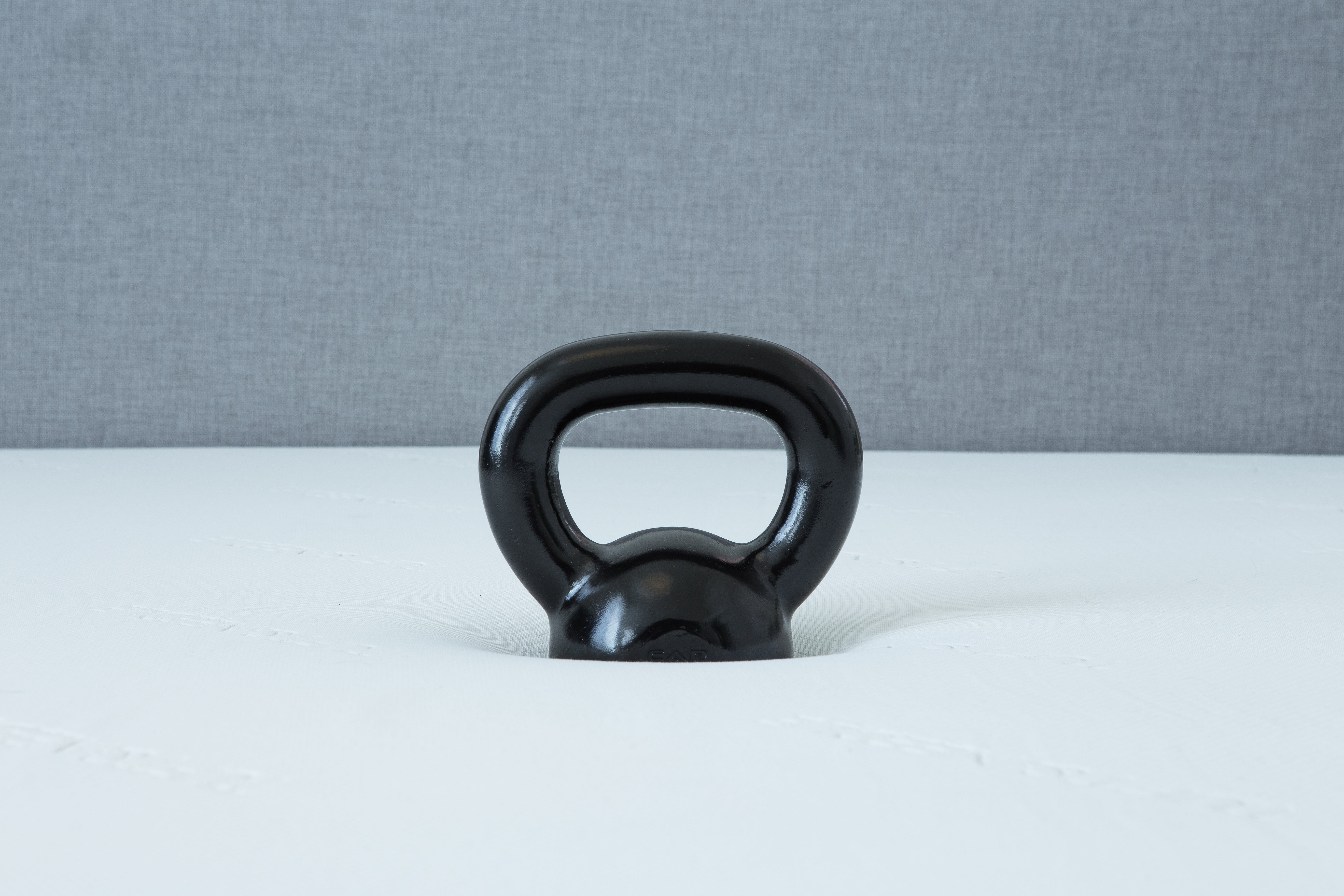 Kettlebell sunk into a Leesa mattress