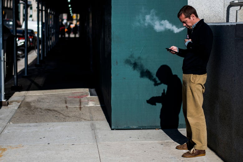 A man smokes an electronic cigarette in New York on November 15, 2017.