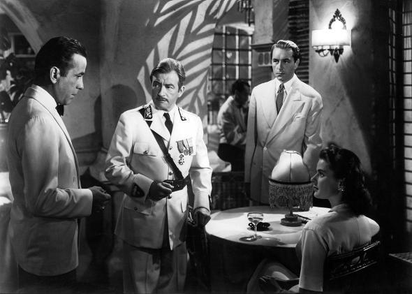 Humphrey Bogart addresses Claude Rains, Paul Henreid, and Ingrid Bergman in Casablanca.