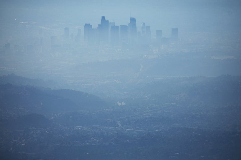 The skyline of down town Los Angeles, as seen from a nearby hilltop, is covered in hazy midday smog.