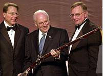Dick Cheney examines a gun with NRA members          Click image to expand.