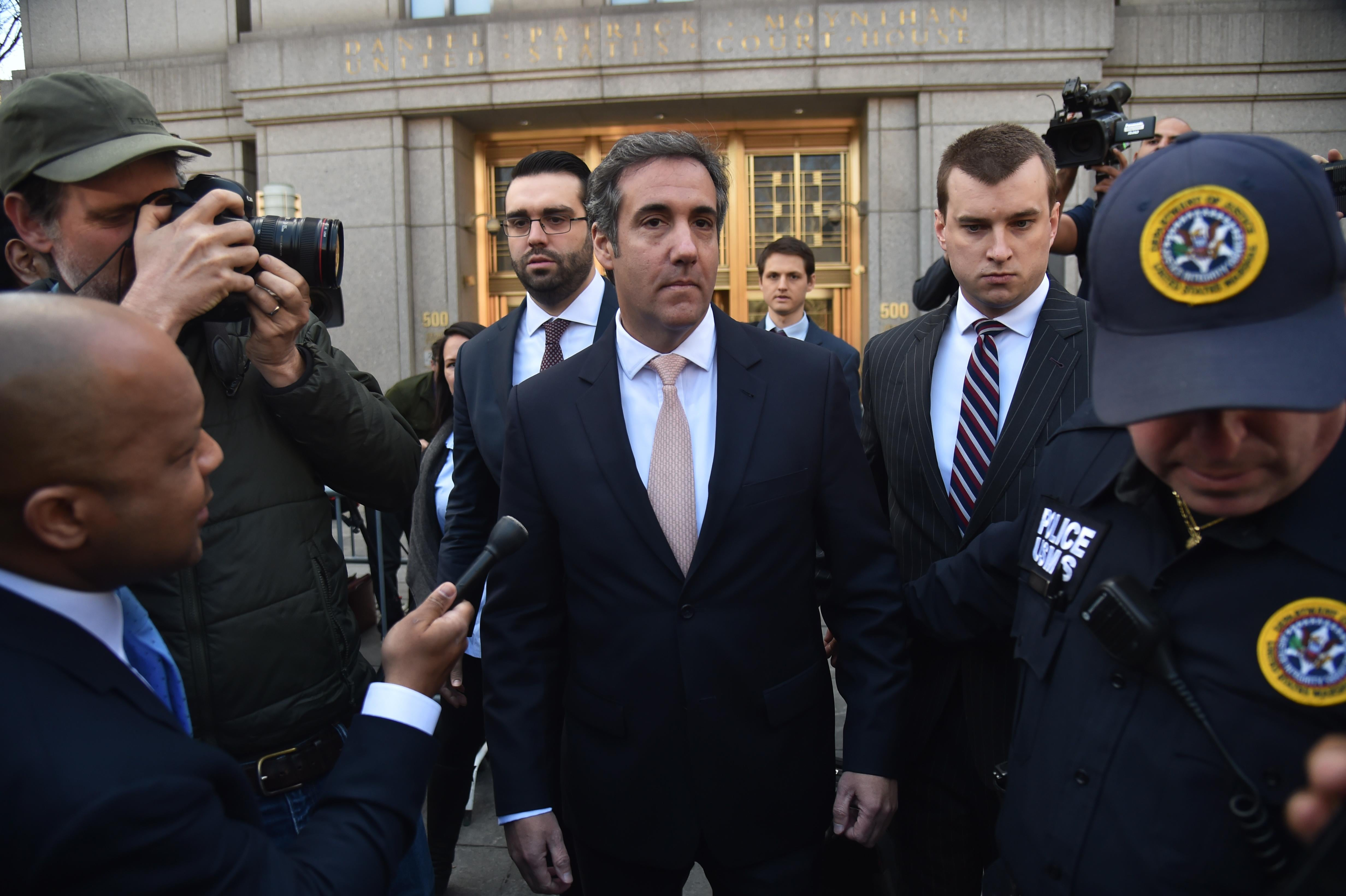 US President Donald Trump's personal lawyer Michael Cohen(C) leaves the US Courthouse in New York on April 26, 2018. - US President Donald Trump acknowledged on Thursday that his personal lawyer, Michael Cohen, represented him in a 'deal' involving porn star Stormy Daniels. Trump had previously denied knowledge of a $130,000 payment Cohen made to Daniels that she claims was to prevent her from talking about their alleged 2006 affair.Trump, in a wide-ranging telephone interview with 'Fox and Friends,' admitted for the first time that Cohen represented him in a 'deal' with Daniels, who has filed a lawsuit seeking to have the 'hush agreement' negotiated by Cohen thrown out. (Photo by HECTOR RETAMAL / AFP)        (Photo credit should read HECTOR RETAMAL/AFP/Getty Images)