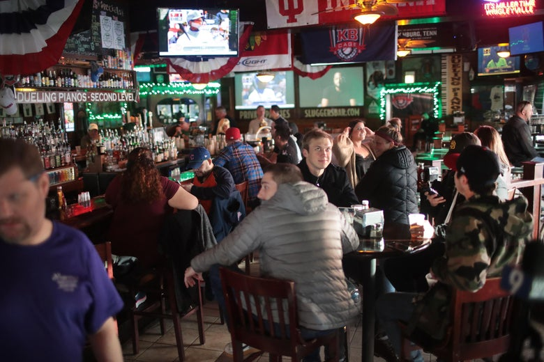 Customers eat and drink at Sluggers, a family-owned sports bar and grill in the shadow of Wrigley Field, on March 15, 2020 in Chicago, Illinois.