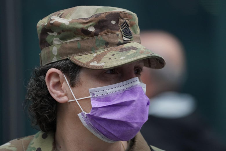 U.S. National Guard soldier wearing a purple facemask.