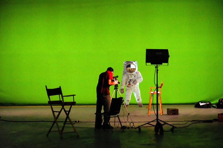 An astronaut standing on a green screen.