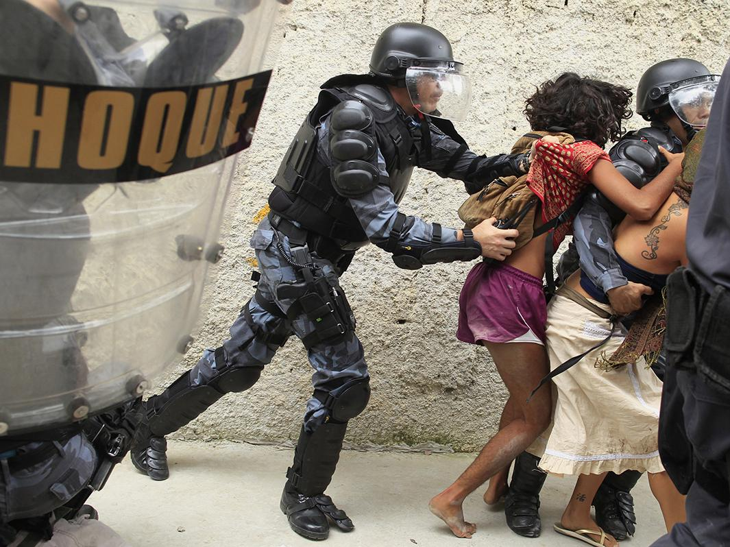 Police officers clash with supporters of the native Indian community in Brazil during a protest outside the Indian museum, next to the Maracana stadium, in Rio de Janeiro, on Dec. 16, 2013