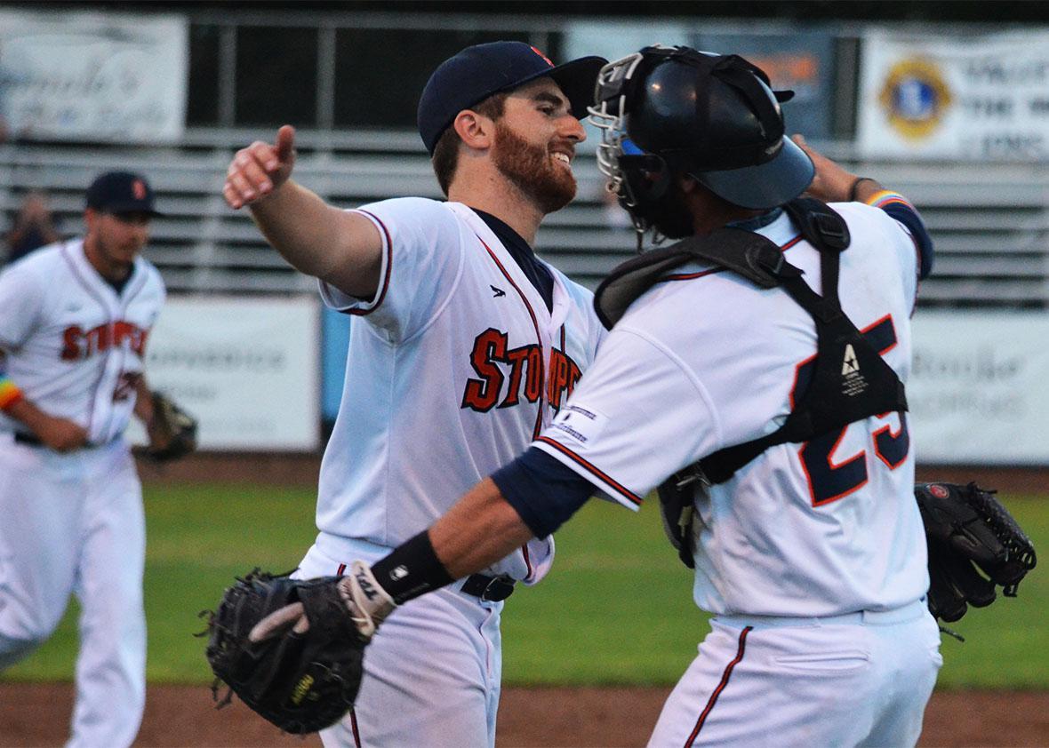 Sean Conroy hugs his catcher Isaac Wenrich.