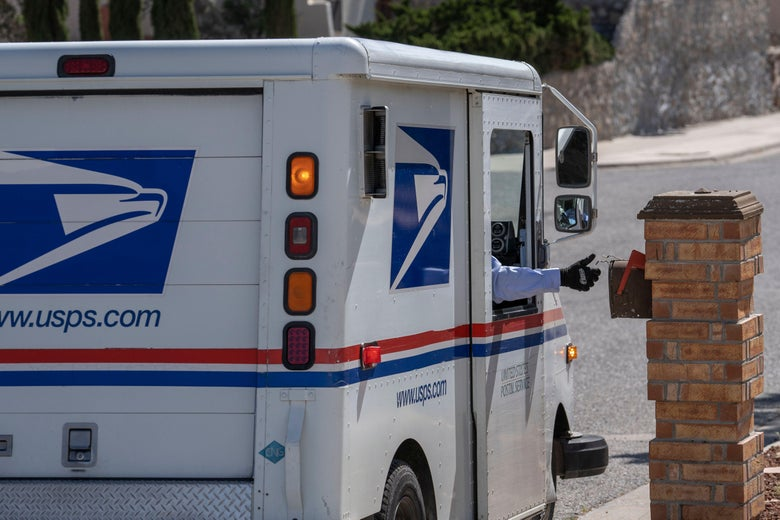 A hand sticks out the window of a mail carrier to place mail inside a mailbox.