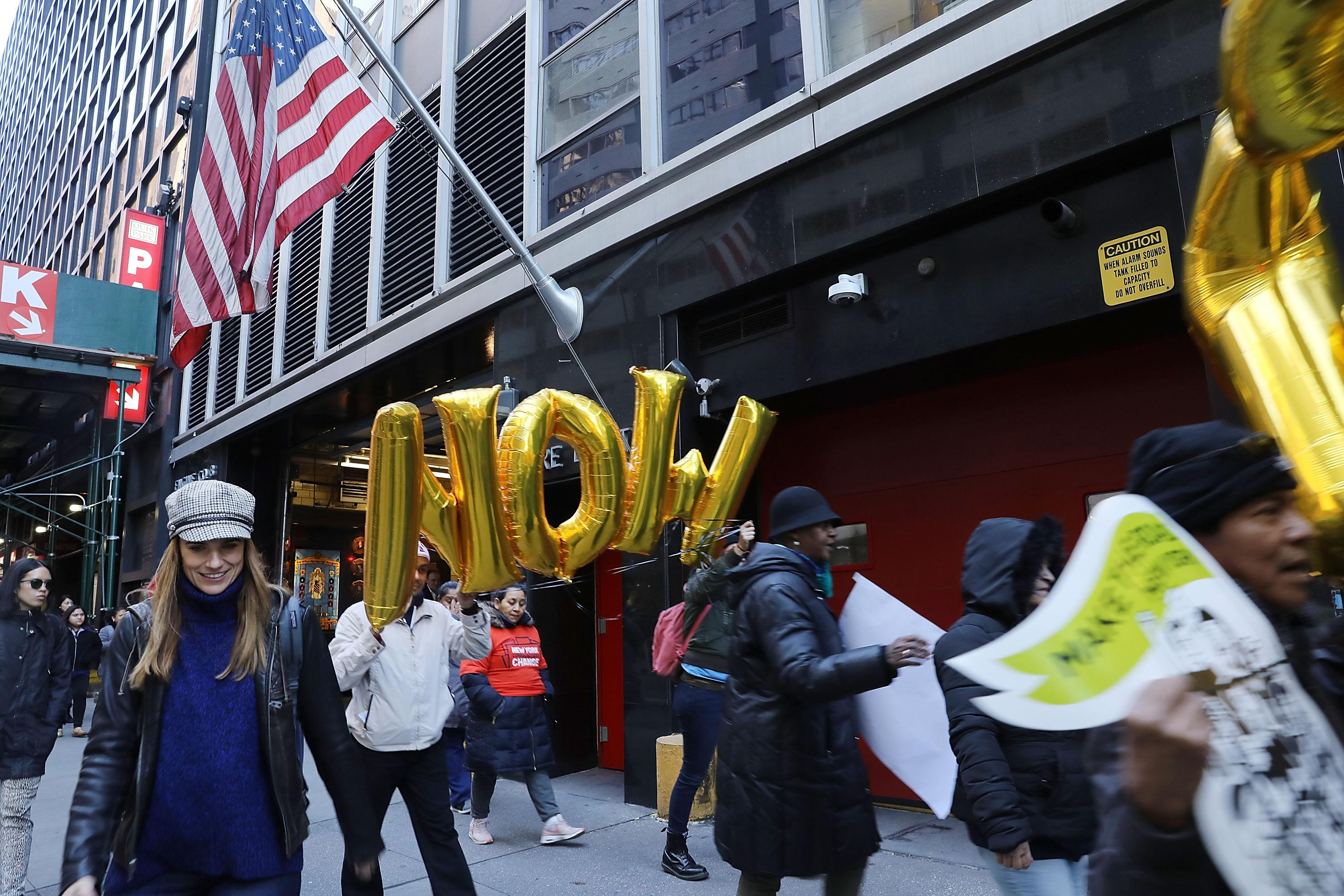 Activists participate in a march and rally outside of three financial companies in New York.