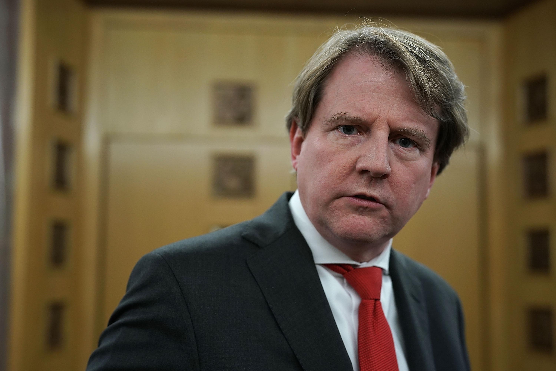 Don McGahn in a dark suit and red tie.