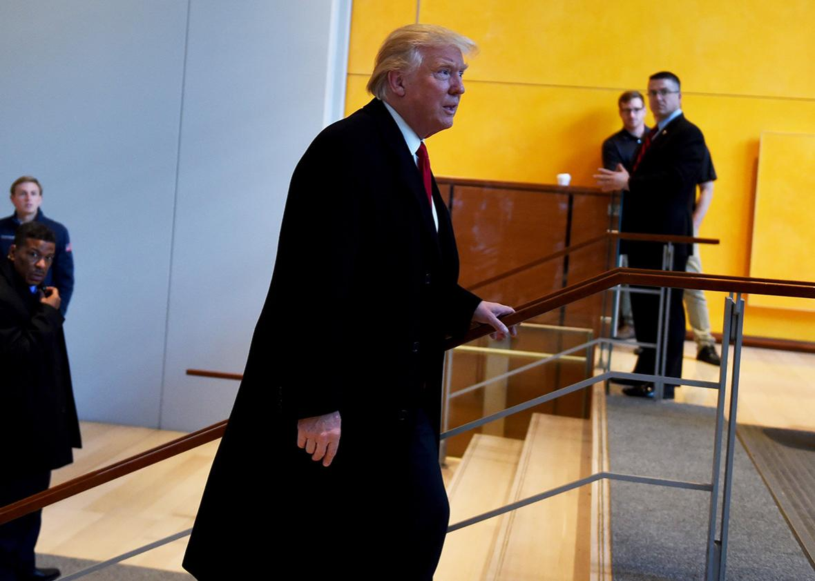 US President-elect Donald Trump leaves after a meeting at the New York Times on November 22, 2016 in New York.
