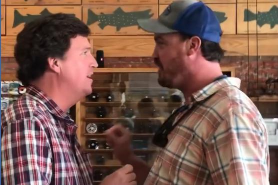 Dan Bailey confronts Tucker Carlson at a fishing store.