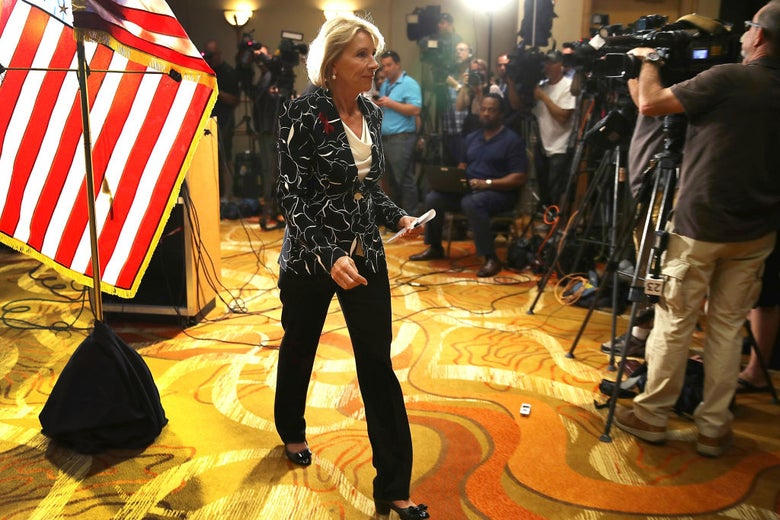 Betsy DeVos leaves a press conference that was held at a hotel near Marjory Stoneman Douglas High School in Parkland, Florida on Wednesday.