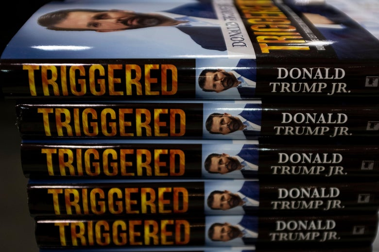 A stack of five hardcover copies of Donald Trump Jr.'s book Triggered, with the spines facing the camera.