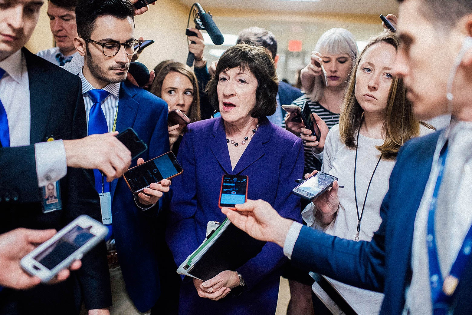 Sen. Susan Collins talks with reporters in the Capitol's Senate subway.