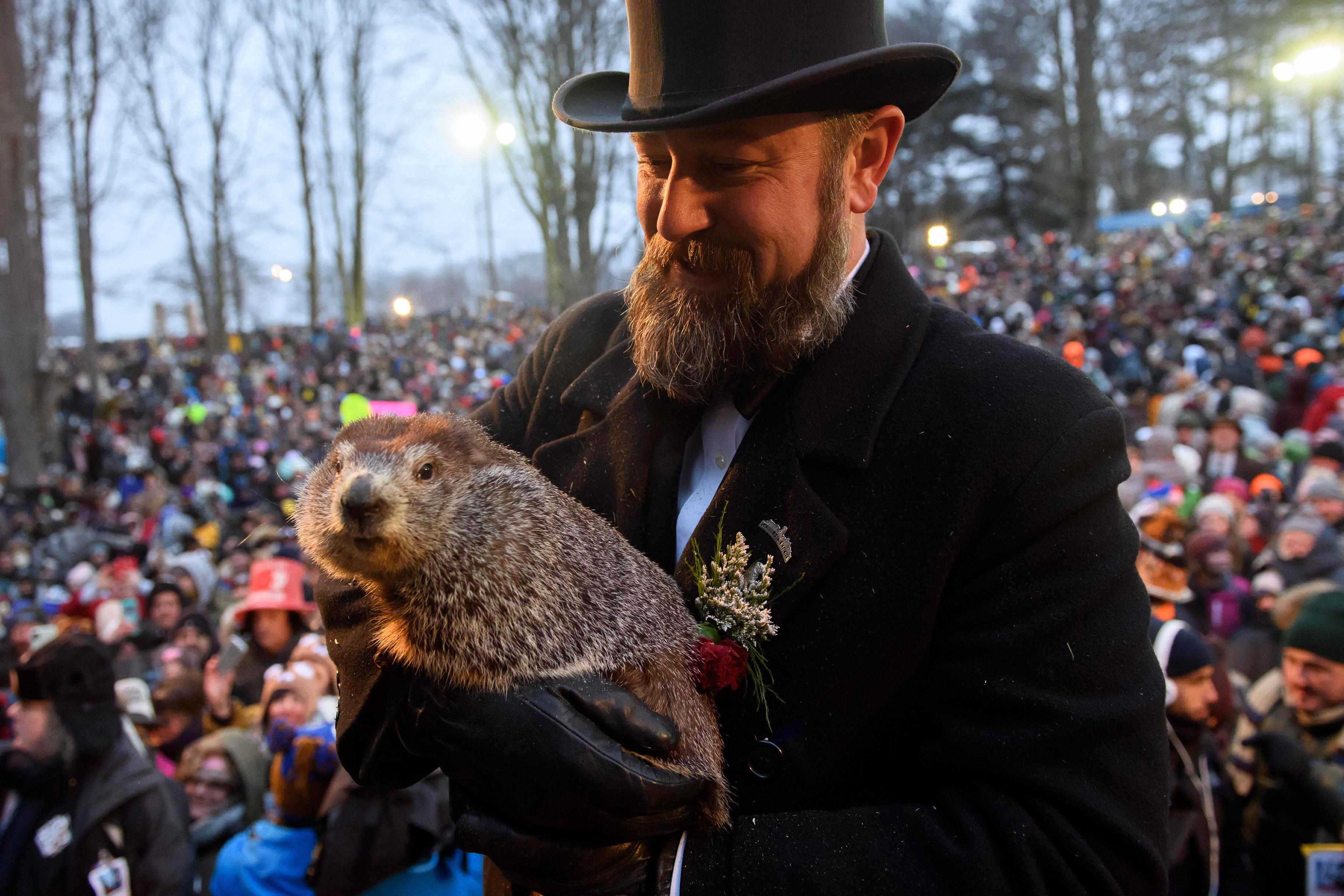 Handler AJ Dereume holds Punxsutawney Phil after he did not see his shadow predicting an early spring during the 133rd annual Groundhog Day festivities on February 2, 2019 in Punxsutawney, Pennsylvania.