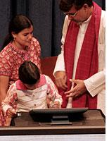 """Devli Kumari signs her name at the """"Education for All"""" pledge summit. Click image to expand."""